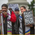 Fight Poverty, Not the Poor sign and people
