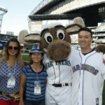 Mike Clark with wife, Emily, mother, Mitsu Clark, and the Mariner Moose